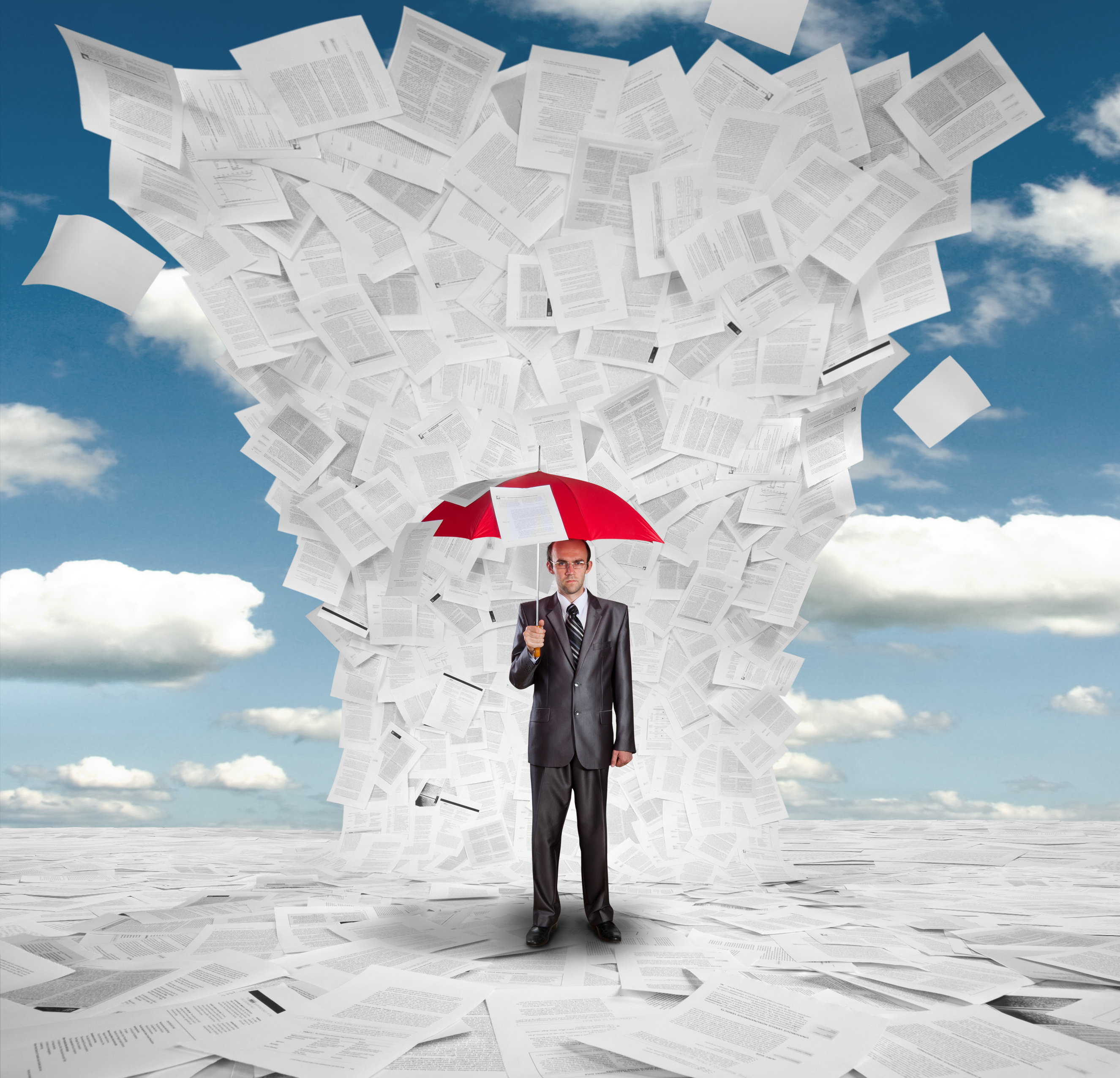 bigstock-Businessman-With-Red-Umbrella--23108744